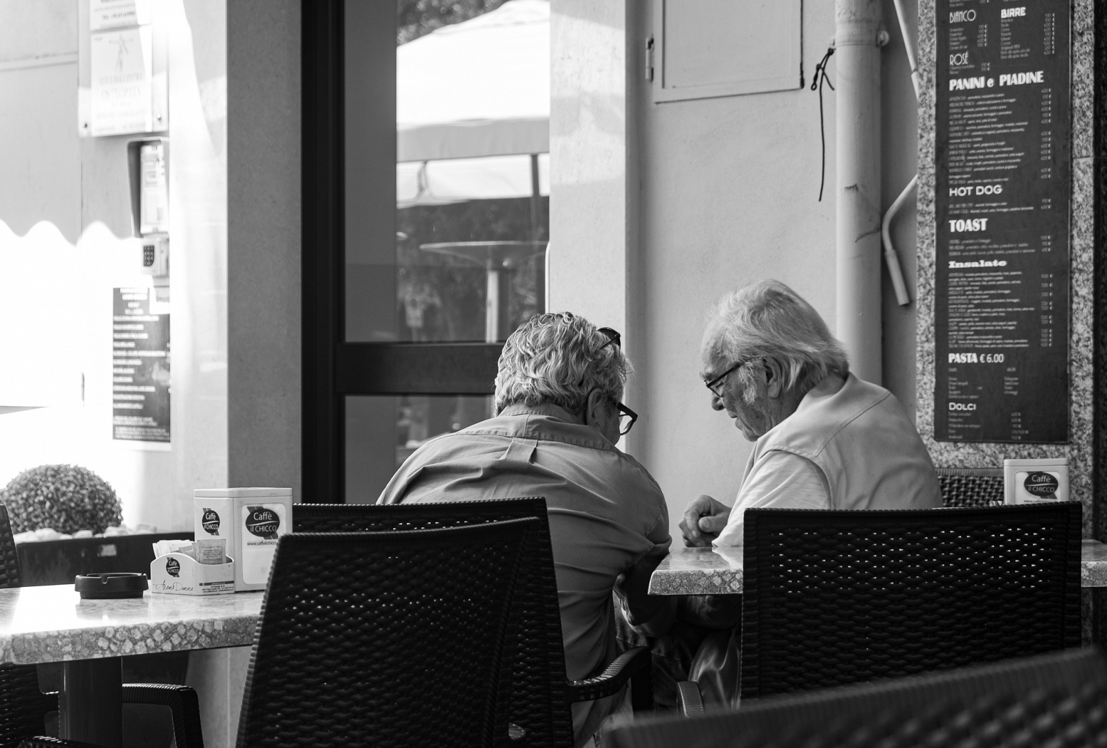 Season's bar - Ventimiglia - Italia - Italian way of life, breakfast and coffee at the bar with an old friend. Best way to start the day
